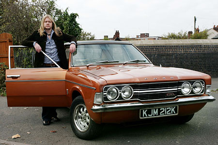 Funky old Cortina: Life on Mars fan Paul Shedden with his shiny Ford Cortina which starred in the BBC police series