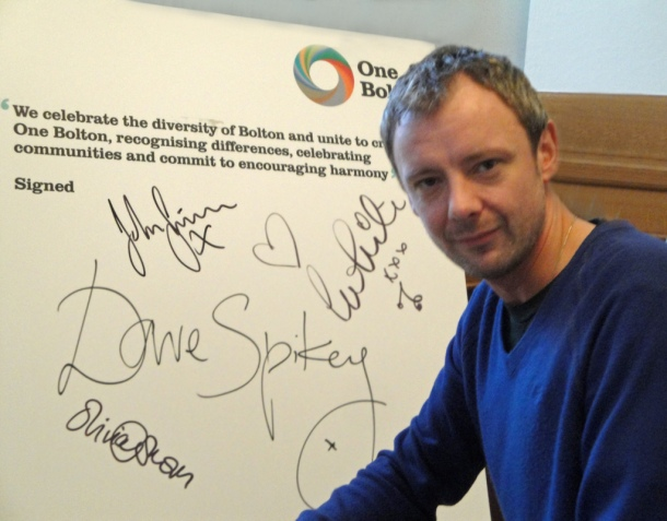 John Simm and the Cast of the upcoming BBC drama Exile have signed up to the One Bolton Pledge. © One Bolton