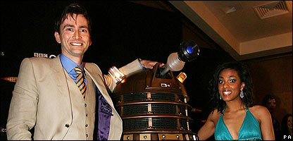 (L-R) David Tennant, Dalek, Freema Agyeman