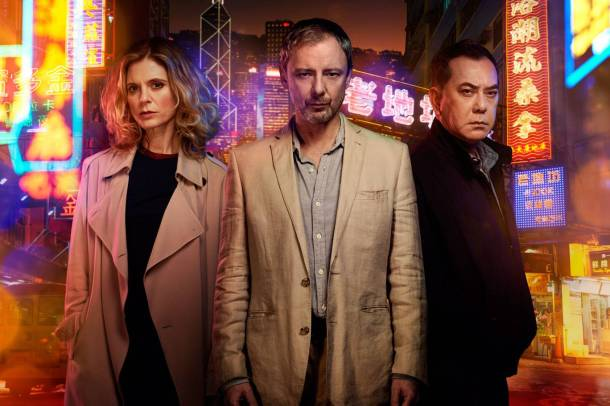 John Simm with co-stars Emilia Fox and Anthony Wong in ITV drama Strangers. Photo: ITV