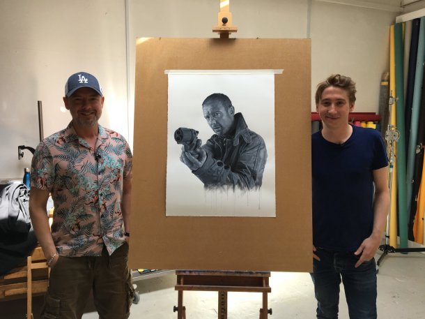 John Simm and artist Joe Simpson with the black and white portrait of John in his chosen role as Rick Deckard from Blade Runner