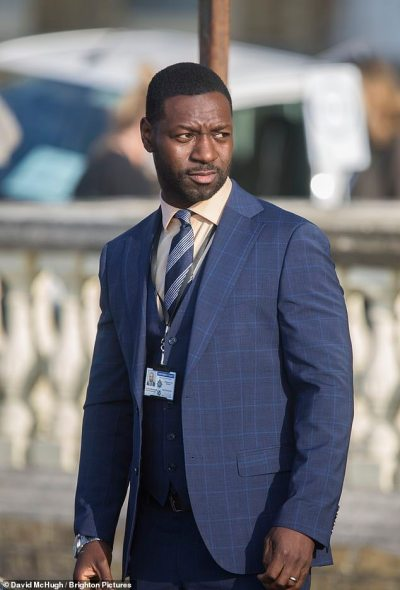 Colleague: Richie (pictured) also put on a dapper display in a dark blue plaid three piece suit, and he completed the outfit by wearing a white shirt and a striped tie